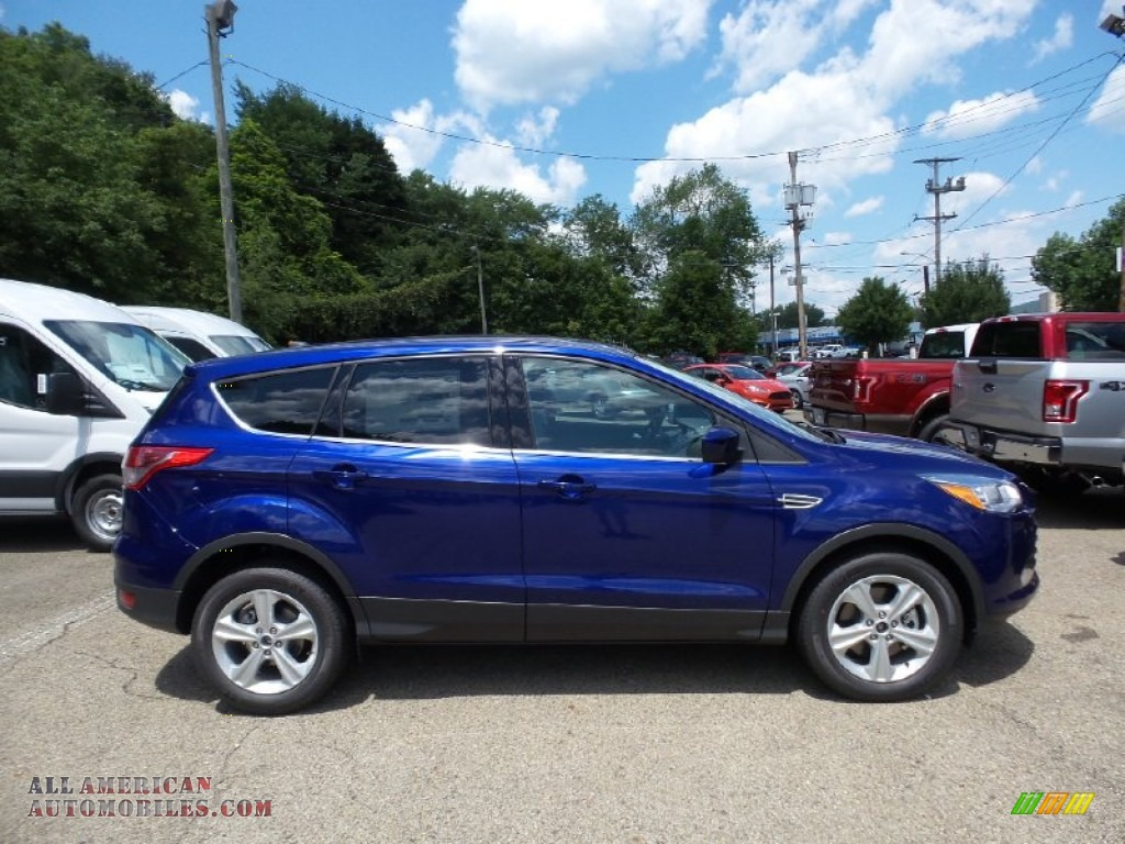 Deep impact blue metallic charcoal black ford escape se 4wd