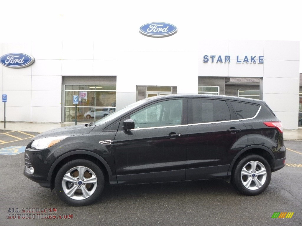 2015 ford escape se 4wd in tuxedo black metallic c22651 all american automobiles buy. Black Bedroom Furniture Sets. Home Design Ideas