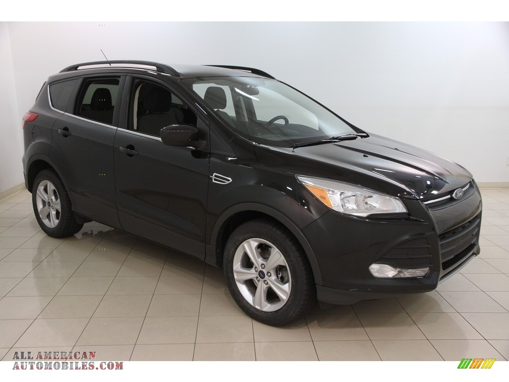 2014 ford escape se 2 0l ecoboost 4wd in tuxedo black d64185 all american automobiles buy. Black Bedroom Furniture Sets. Home Design Ideas