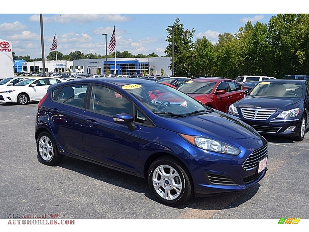 2016 ford fiesta se hatchback in kona blue metallic 128460 all american automobiles buy. Black Bedroom Furniture Sets. Home Design Ideas
