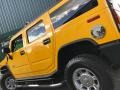 Hummer H2 SUV Yellow photo #23
