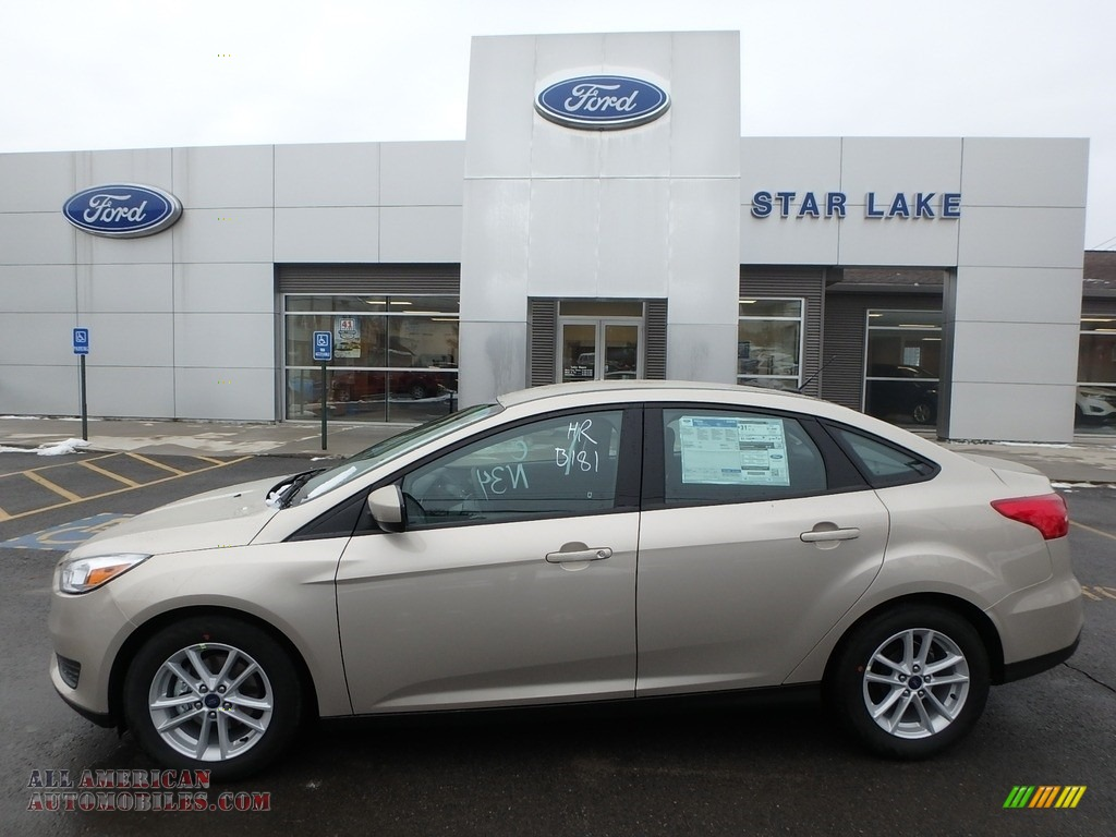White Gold / Medium Light Stone Ford Focus SE Sedan