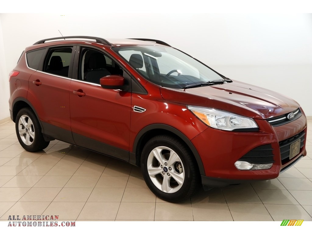 Sunset Metallic / Charcoal Black Ford Escape SE