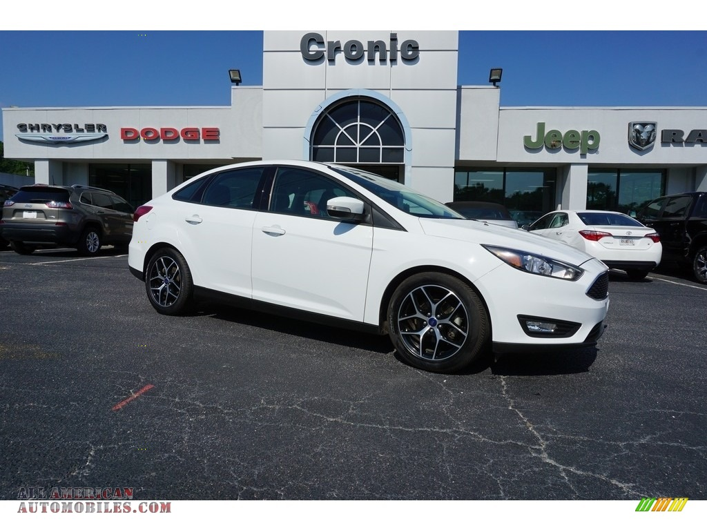 Oxford White / Charcoal Black Ford Focus SEL Sedan