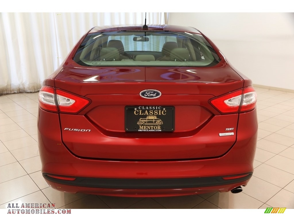 2013 Fusion SE 1.6 EcoBoost - Ruby Red Metallic / Dune photo #18