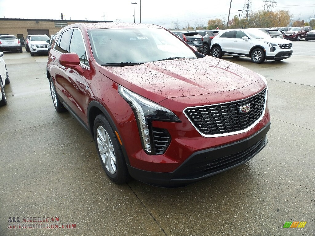 Red Horizon Tintcoat / Light Platinum/Jet Black Cadillac XT4 Luxury AWD