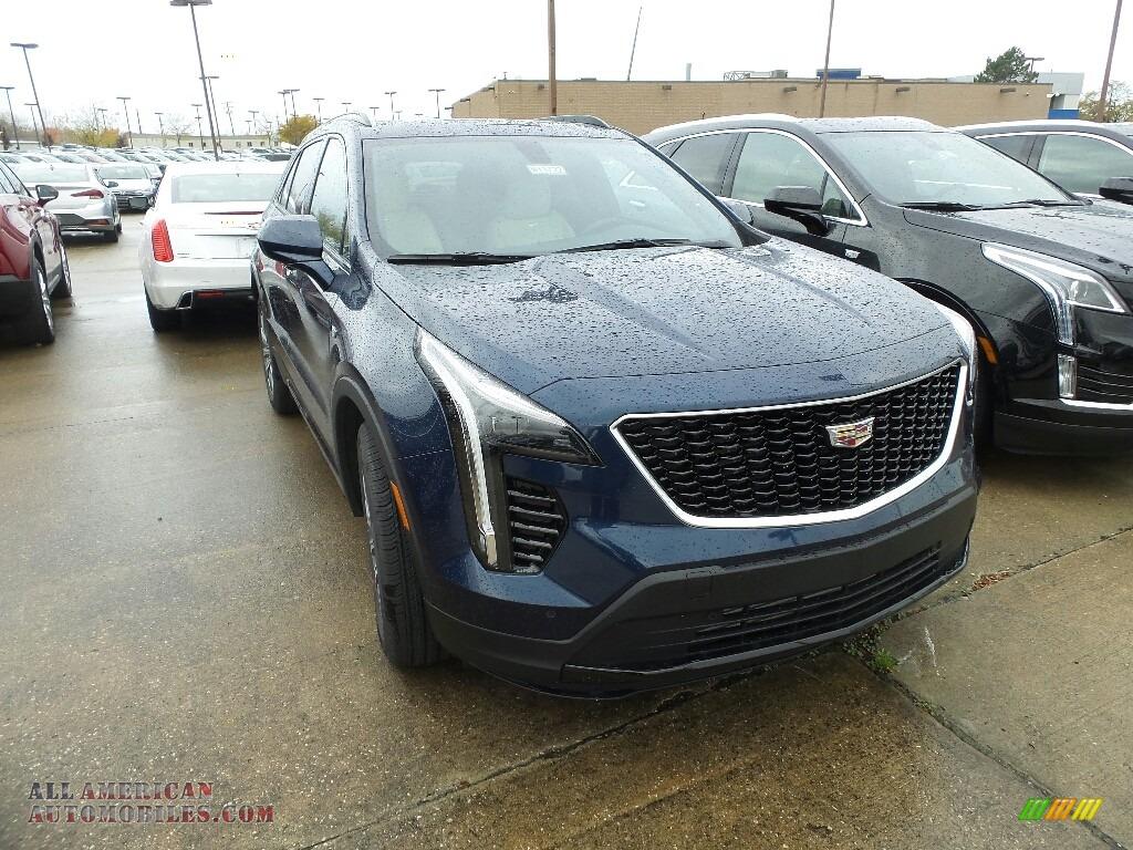 Twilight Blue Metallic / Light Wheat/Jet Black Cadillac XT4 Sport AWD