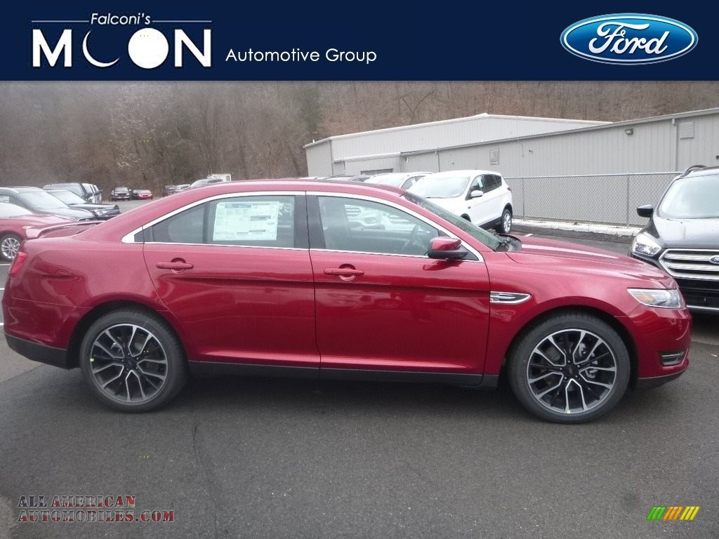 Ruby Red / Charcoal Black Ford Taurus SEL AWD