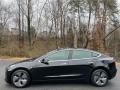 Tesla Model 3 Performance Solid Black photo #1