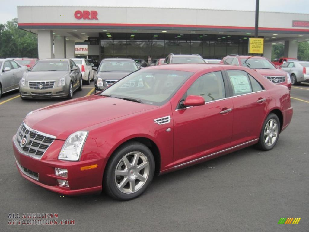 2011 cadillac sts v6 sport in crystal red tintcoat 160215 all american automobiles buy. Black Bedroom Furniture Sets. Home Design Ideas