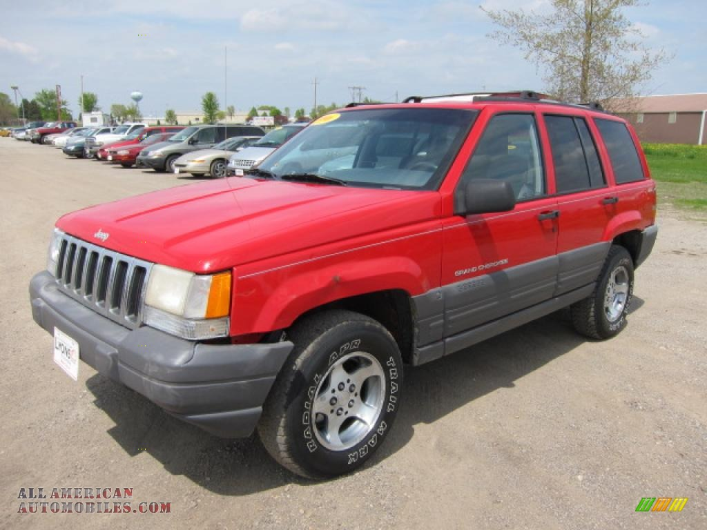 1996 jeep grand cherokee laredo 4x4 in flame red 203451 all american automobiles buy. Black Bedroom Furniture Sets. Home Design Ideas