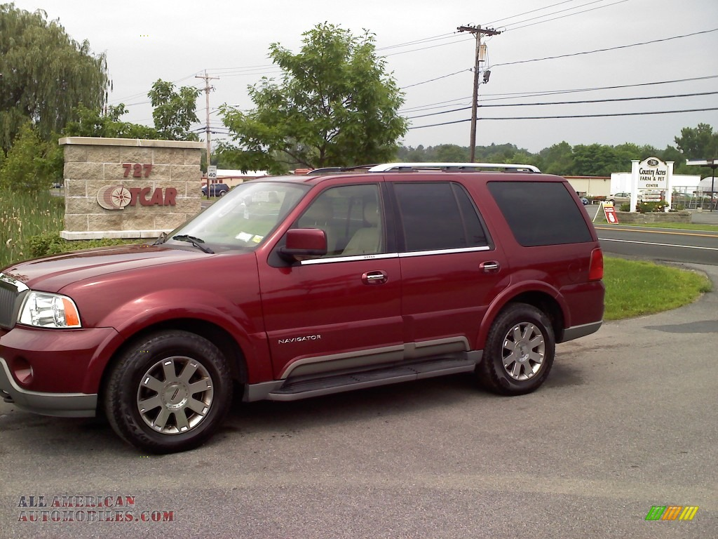2004 lincoln navigator luxury 4x4 in merlot red metallic j15443 all american automobiles. Black Bedroom Furniture Sets. Home Design Ideas