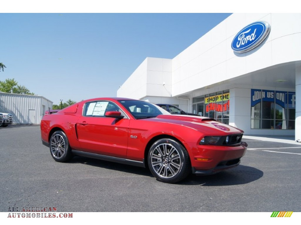 2012 ford mustang gt premium coupe in red candy metallic 231548 all american automobiles. Black Bedroom Furniture Sets. Home Design Ideas