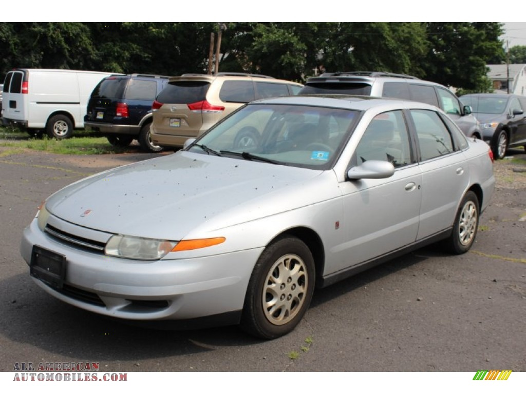 2002 saturn l series l200 sedan in bright silver 576511 all american automobiles buy. Black Bedroom Furniture Sets. Home Design Ideas