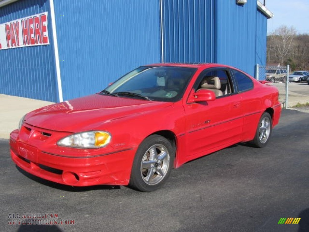 1999 pontiac grand am gt coupe in bright red 897329 all american automobiles buy american. Black Bedroom Furniture Sets. Home Design Ideas