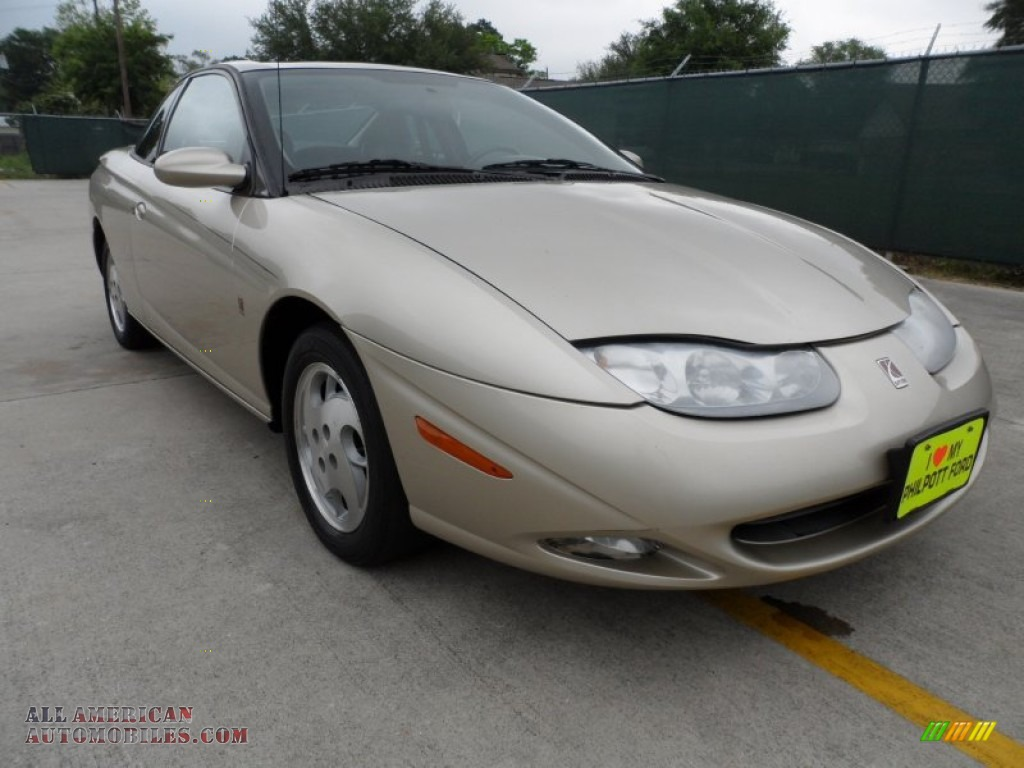 2002 saturn s series sc2 coupe in gold 154940 all american automobiles buy american cars. Black Bedroom Furniture Sets. Home Design Ideas