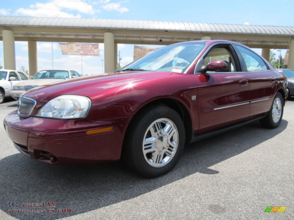 Merlot Red Metallic / Medium Parchment Mercury Sable LS Premium Sedan