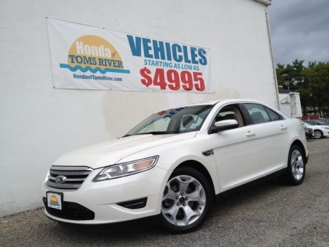 White Suede Metallic 2010 Ford Taurus SEL
